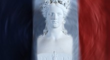 "This photoshopped picture shows a statue representing Marianne, the embodiment of the French Republic, in front of a French flag, at the Creully city-hall, 03 October 2006. Marianne represents the permanent values of French Republic: ""Liberty, Equality, Fraternity"". AFP PHOTO MYCHELE DANIAU"